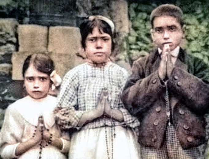 The three children of Fatima — Lúcia Santos (center, age 10) and her two cousins, Francisco (age 9) and Jacinta Marto (age 7) — stand with their rosaries in this 1917 photo.