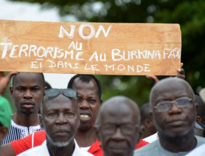 Protesters demonstrate against terrorism in central Ouagadougou on August 19, 2017.