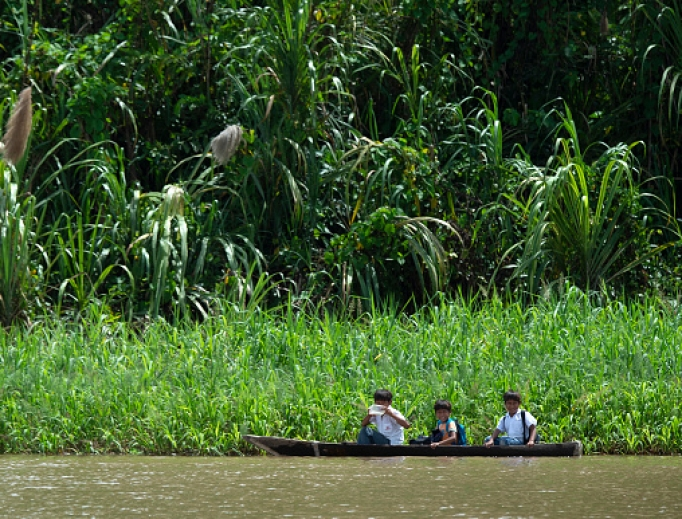 Children go to school by canoe on the Maranon River, a main tributary of the Amazon River in the Pacaya Samiria National Reserve, on May 24. The upcoming Pan-Amazonian synod will address issues of importance to the Church in the Amazon region.