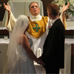 A shower of bubbles greets Jamie and Zac O'Brien as they leave St. Joseph's Church in Pekin, Ill., after their wedding Mass in July 2007.