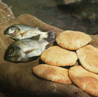 """Did Jesus feed 5,000 men (plus women and children) with just five loaves and two fish? Or was there a """"miracle of sharing""""?"""