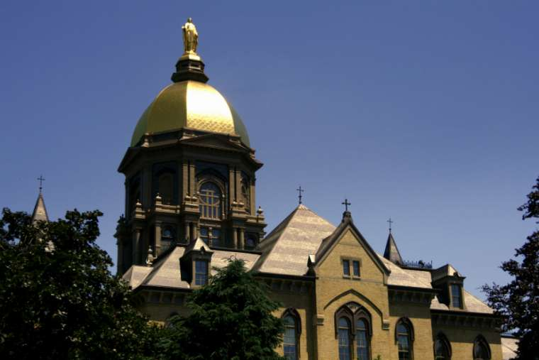 The University of Notre Dame's Main Building, which houses the murals that will soon be 'covered by woven material consistent with the décor.'