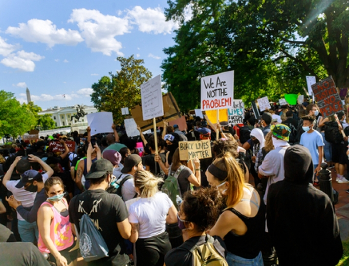 Protesters march after death George Floyd, group standing against White House on May 31, 2020.
