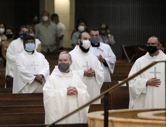 Above, priests from the Rio Grande Valley wear face masks against the spread of the coronavirus as they attend a priestly ordination Mass June 20 at the Basilica of Our Lady of San Juan Del Valle in San Juan, Texas.