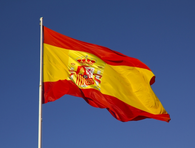 Spanish flag flying in the wind.