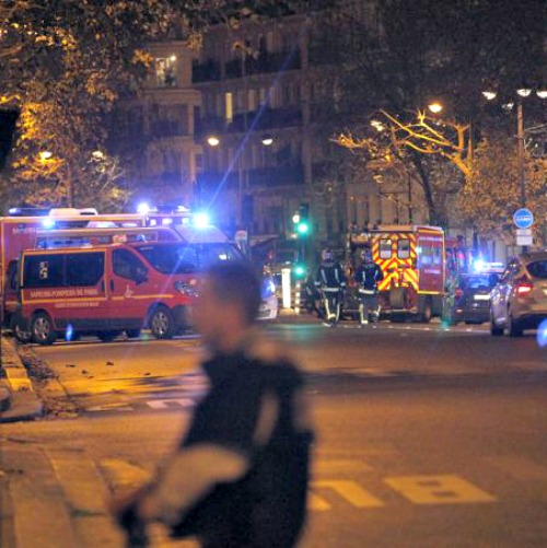 Police survey the area of Boulevard Baumarchais after an attack in the French capital on Nov. 13 in Paris.