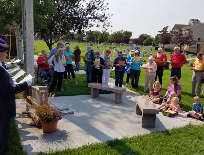 People gather in prayer on past National Days of Remembrance for Aborted Children: Billings, Montana, 2018 (above); and Hillside, Illinois, 2018 (below); and Scranton, Pennsylvania, 2017 (below). This year the date is Sept. 14. Below, memorial wreaths are set up at a special Mass via Elizabeth Ministry; and the Ray family is shown mourning a miscarried family member.