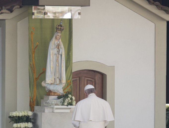 Pope Francis prays at the Shrine of Our Lady of Fatima May 12.