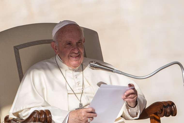Pope Francis speaks at the general audience Oct. 9.