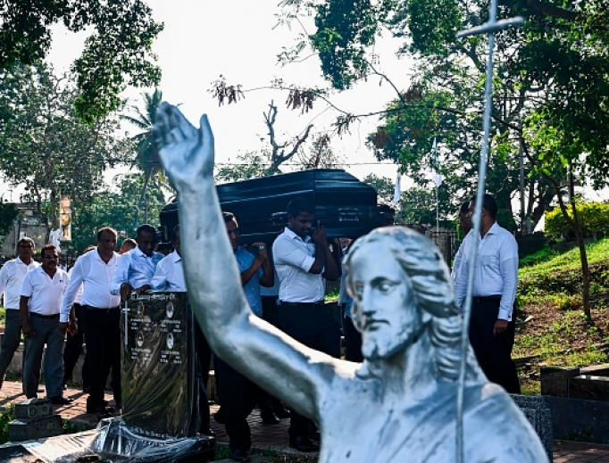 Relatives carry the coffin of a bomb blast victim during a burial ceremony at a cemetery in Colombo on April 24, three days after a series of suicide attacks targeting churches and luxury hotels in Sri Lanka that killed more than 350 people, despite prior intelligence warnings.