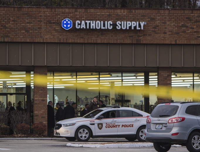 Authorities investigate the scene at Catholic Supply retail store where a gunman went into the religious supply store, sexually assaulted at least one woman and shot a woman in the head Nov. 19 in Ballwin, Missouri.