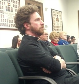 Father Peter Mussett, St. Thomas Aquinas Catholic Center pastor/director of campus ministry at the University of Colorado-Boulder, listens during a Jan. 27 state Legislature committee hearing on religious liberty.