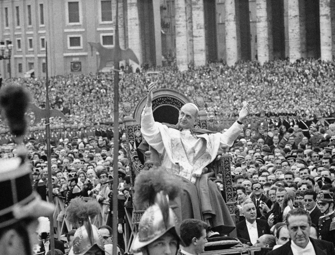 In this file photo taken on March 29, 1964, Pope Paul VI waves to a crowd estimated at 200,000 in St. Peter's Square in Vatican City. Paul VI reaffirmed the Church's ban on artificial contraception in his landmark 1968 encyclical.