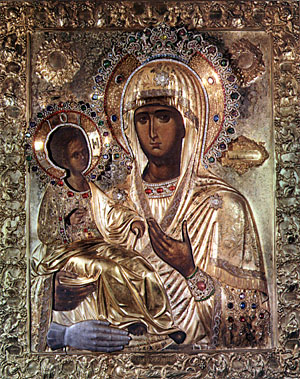 Icon of Mary as the Theotokos. The hand in silver at the bottom is a votive offering related to a miracle of St. John Damascene.