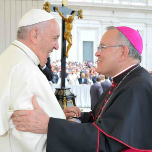 Pope Francis greets Archbishop Charles Chaput of Philadelphia at his general audience in St. Peter's Square on June 24.