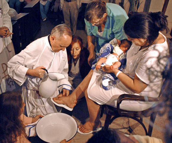 The future Pope Francis washes the feet of a unidentified woman on Holy Thursday at the Buenos Aires' Sarda maternity hospital on March 24, 2005.