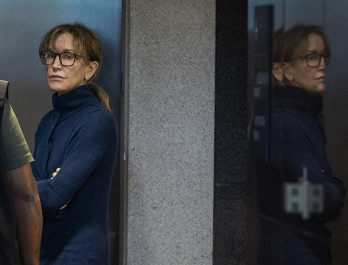 Actress Felicity Huffman is seen inside the Edward R. Roybal Federal Building and U.S. Courthouse in Los Angeles March 12. Hollywood actresses Huffman and Lori Loughlin are among 50 people indicted in a nationwide university-admissions scam, court records unsealed in Boston March 12 showed. A federal judge set bond at $250,000 for Huffman after she was charged in the cheating scandal.