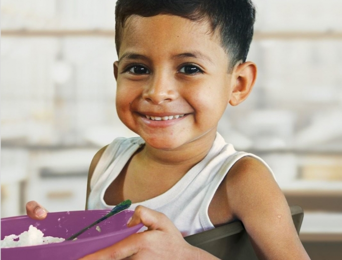 Above, Cross Catholic Outreach provides meals around the world and continues to do so amid the pandemic