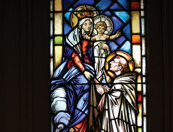 A window at the National Shrine of Our Lady of Mount Carmel in Middletown, New York, depicts Our Lady appearing to St. Simon Stock in 1251 in Aylesford, England, to give him the Brown Scapular.