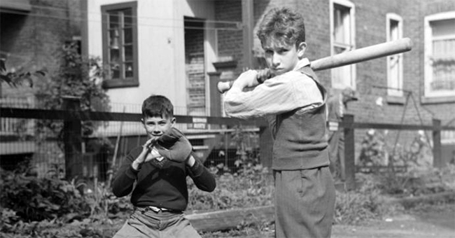 Sidney Rosenzweig and Owen Kennedy play baseball in the summer camp of the Young Men's Christian Association (YMCA) of Westmount.