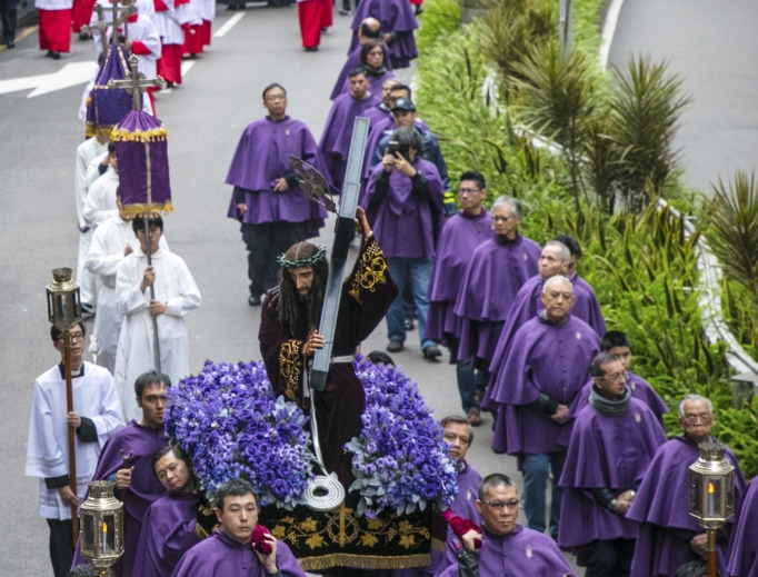 Hundreds of Catholics take part in a solemn procession of the Way of the Cross in Macau, China, March 10. The procession began at the cathedral and finished at St. Augustine's Church.