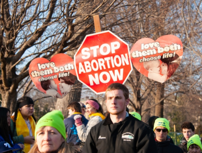 Students carry signs during March for Life, 2019.