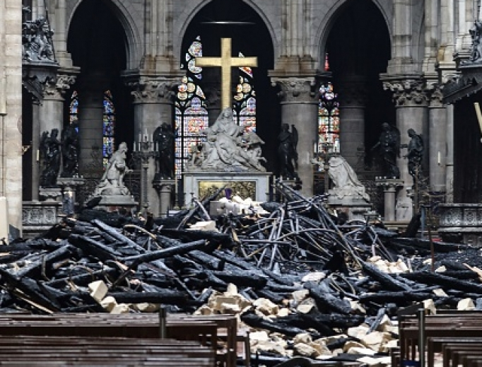 The Notre Dame altar is surrounded by charred debris April 16 amid the aftermath of the fire that devastated the cathedral April 15.