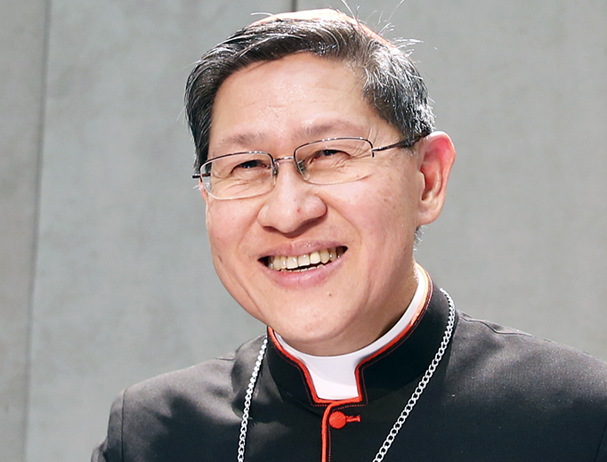 Cardinal Luis Tagle speaks at a Sept. 27, 2017, media conference at the Holy See Press Office in Rome.
