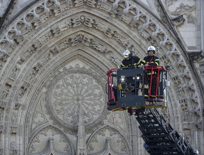 Two members of the fire brigade battle the blaze during the Nantes Cathedral fire on July 18, 2020.