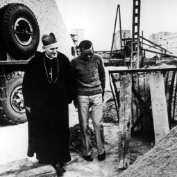 In an undated photo, Cardinal Karol Wojtyla visits with a worker at the site of the future Mother of God, Queen of Poland Church in Nowa Huta, Poland. After years of negotiations, the future Pope John Paul II received permission from Polish communist authorities to begin construction. He laid the cornerstone on his 49th birthday. Pope Paul VI donated the cornerstone, an original brick from Constantine's ancient Basilica of St. Peter in Rome.
