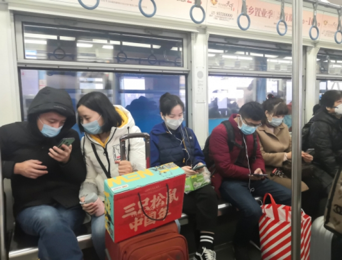 Passengers on train in Hong Kong wearing medical masks, January 12, 2020.