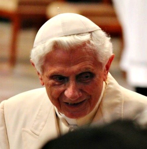 Pope Benedict XVI greets participants at the Feb. 22 consistory in St. Peter's Basilica.