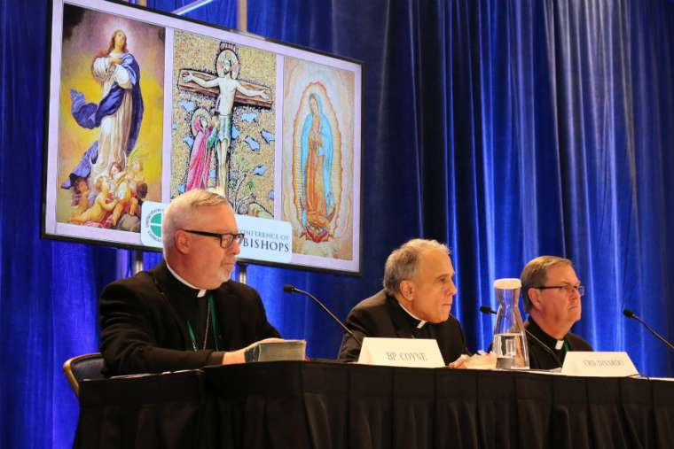 From left to right: Bishop Christopher Coyne, Cardinal Daniel DiNardo and Bishop Timothy Doherty at the USCCB news conference in Baltimore Nov. 12.