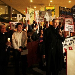Cardinal Roger Mahony of Los Angeles speaks with supporters of the DREAM Act at the start of a Dec. 7 procession in downtown Los Angeles to Our Lady Queen of the Angels Church as part of a national candlelight vigil. The Development, Relief and Education for Alien Minors Act would provide a chance for legal status and eventual citizenship for young people who were brought into the United States illegally as children and educated here or who serve in the military here.