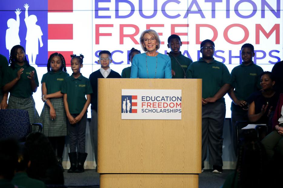 Education Secretary Betsy DeVos stands in front of students from Digital Pioneers Academy during an event to discuss her proposal for Education Freedom Scholarships at the Education Department headquarters Feb. 28. According to the department, the scholarships would 'significantly expand education freedom for millions of students and families across the country.'
