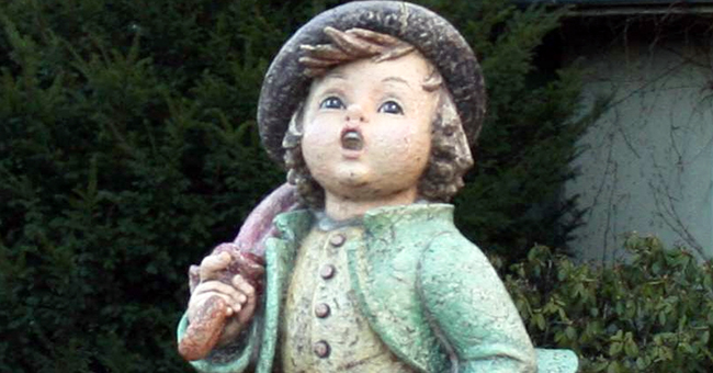 """Life-size reproduction of a Hummel figurine, """"Merry Wanderer"""", at the entrance of the Goebel company in Rödental, Germany."""