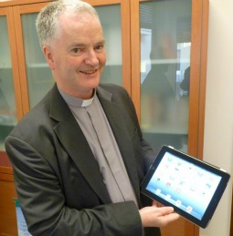 Msgr. Paul Tighe with the tablet used to send the Pope's first tweet.