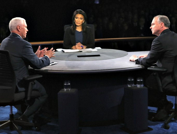 Republican vice-presidential nominee Mike Pence (l) and Democratic vice-presidential nominee Tim Kaine debate as moderator Elaine Quijano listens during the Vice-Presidential Debate at Longwood University on Oct. 4 in Farmville, Virginia.