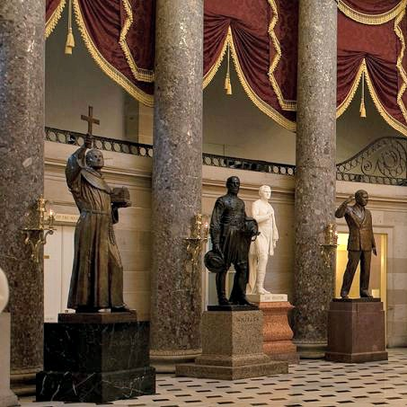 The statue of Blessed Junípero Serra (far left) inside the National Statuary Hall in Washington.