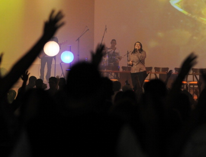 A singer performs during a religious ceremony for young people at an evangelical church in Brasilia.