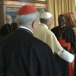 Pope Francis greets members of the council of cardinals at the start of their first meeting, Oct. 1, 2013.