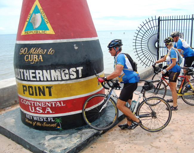 FINISH LINE.  Father Matthew Ruhl reaches Key West after his 5,052-mile cycling trek to increase awareness about poverty in America.