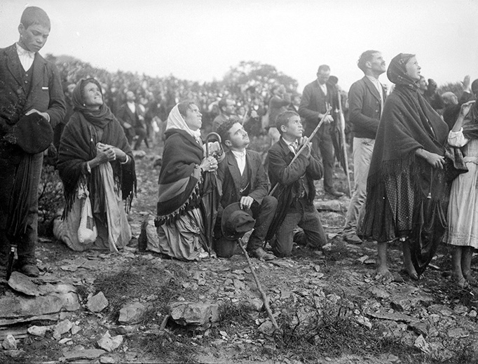 A crowd watches the 'Miracle of the Sun' during the apparition of Our Lady of Fatima on October 13, 1917.