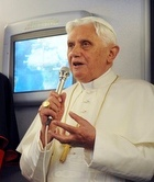 The Pope speaks to journalists aboard the papal plane March 17.