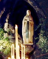 A statue of Mary in the grotto at Lourdes.