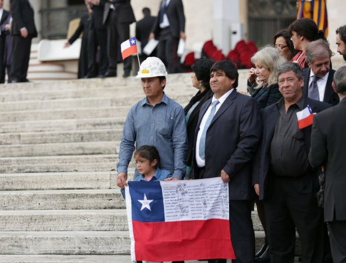 Pilgrims from Chile wait for Pope Francis in St. Peter's Square during the Wednesday general audience Oct. 14, 2015.
