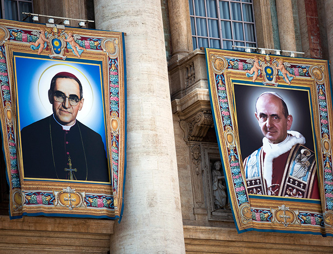 Special banners with the official portraits of Pope Paul VI and Archbishop Óscar Romero hang on the facade of St. Peter's Basilica before the Oct. 14 Canonization Mass.