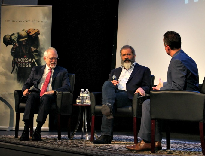 David DiCerto (r), the director of film and television at the Archbishop Fulton J. Sheen Center for Thought and Culture, interviews screenwriter Robert Schenkkan and director Mel Gibson Wednesday at a screening of their film, 'Hacksaw Ridge,' at the Sheen Center in New York.