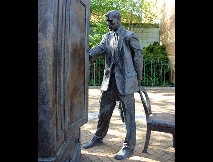 Entitled 'The Searcher', this Belfast statue of C.S. Lewis looking into a wardrobe was sculpted by Ross Wilson.