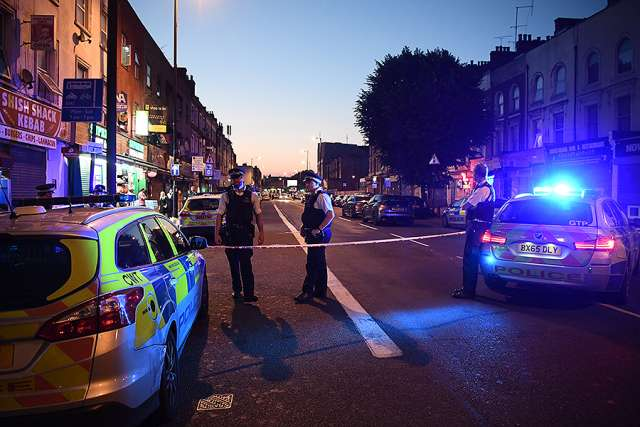Police officers guard a road leading to Finsbury Park Mosque after a van hit worshippers outside the building on June 19 in London.